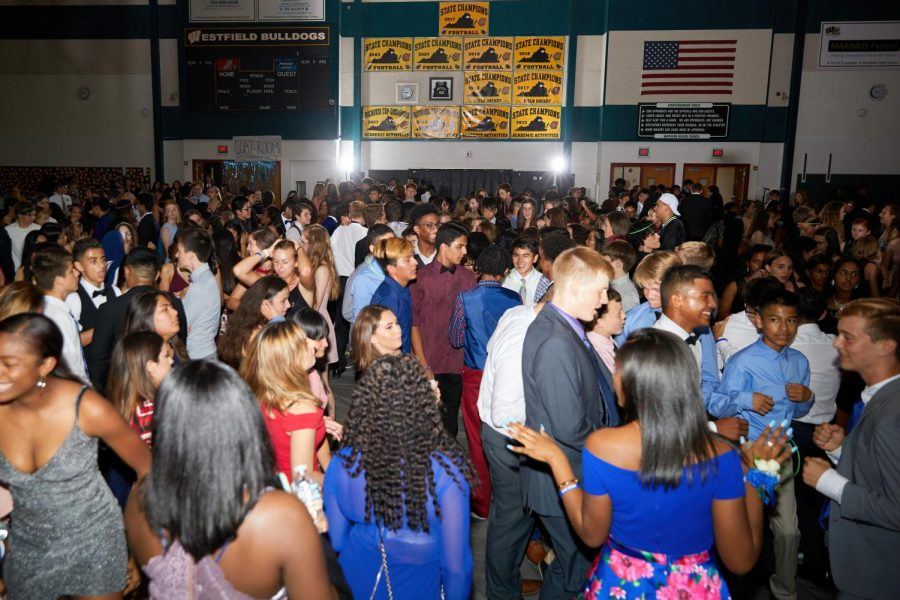 Students dancing in the packed gym for Homecoming.