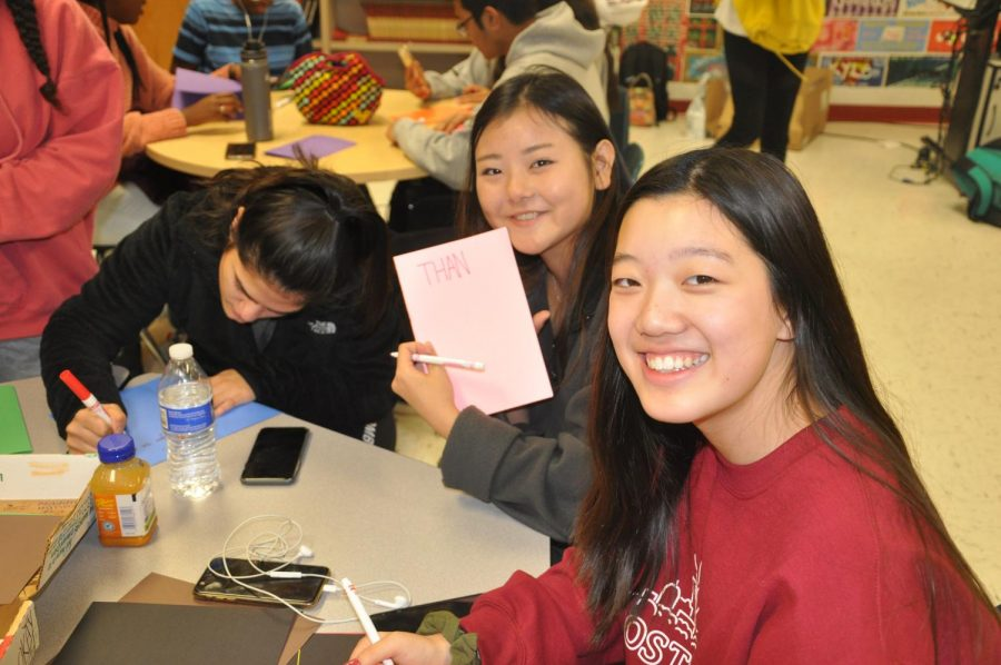 (left to right) Marwa Aminzay, 11, Nao Ishibashi, 11, and Isabel Yi, 11, making cards for soldiers overseas during SGA's Operation Gratitude event.