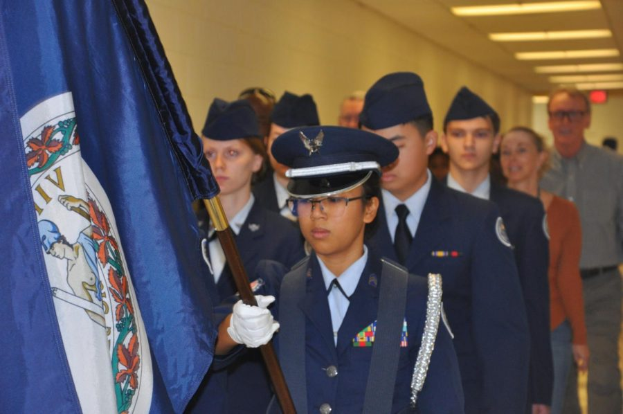 JROTC marching across the hallways during the teacher veteran march.