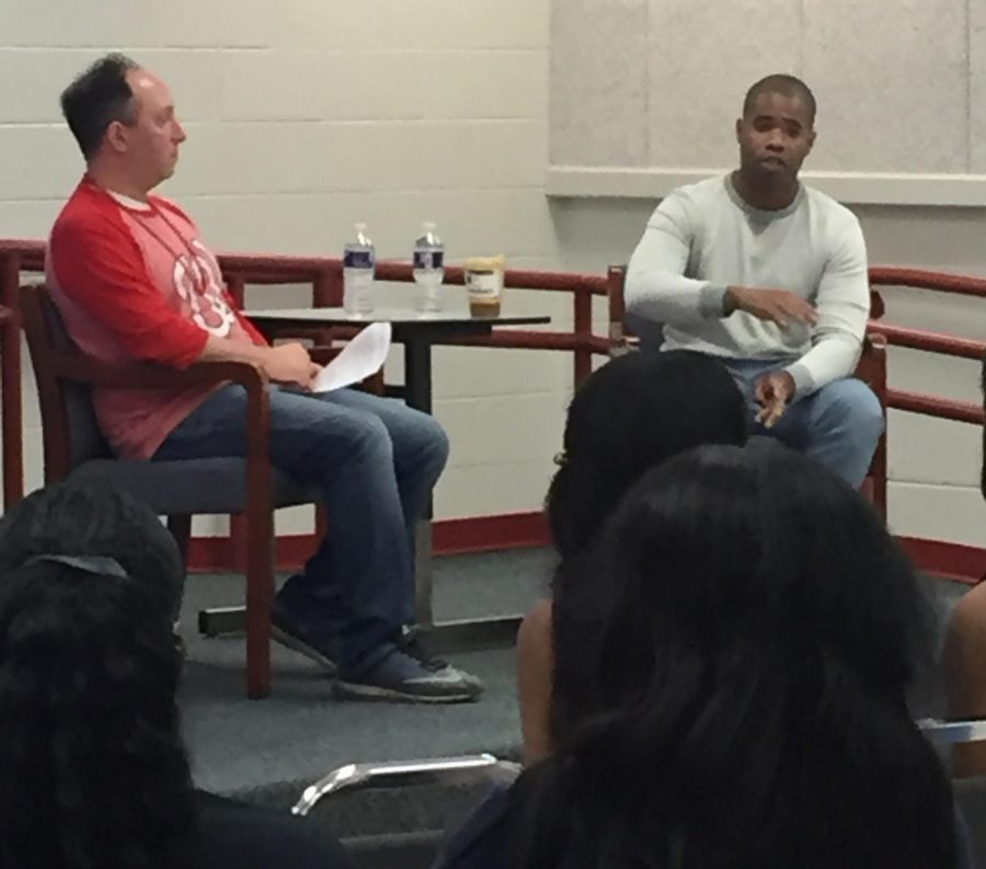 Jeffrey Alston (left) advises students about his career