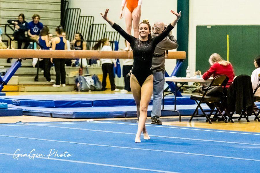 Paige Perez, 12, performing at a Gymnastics meet.