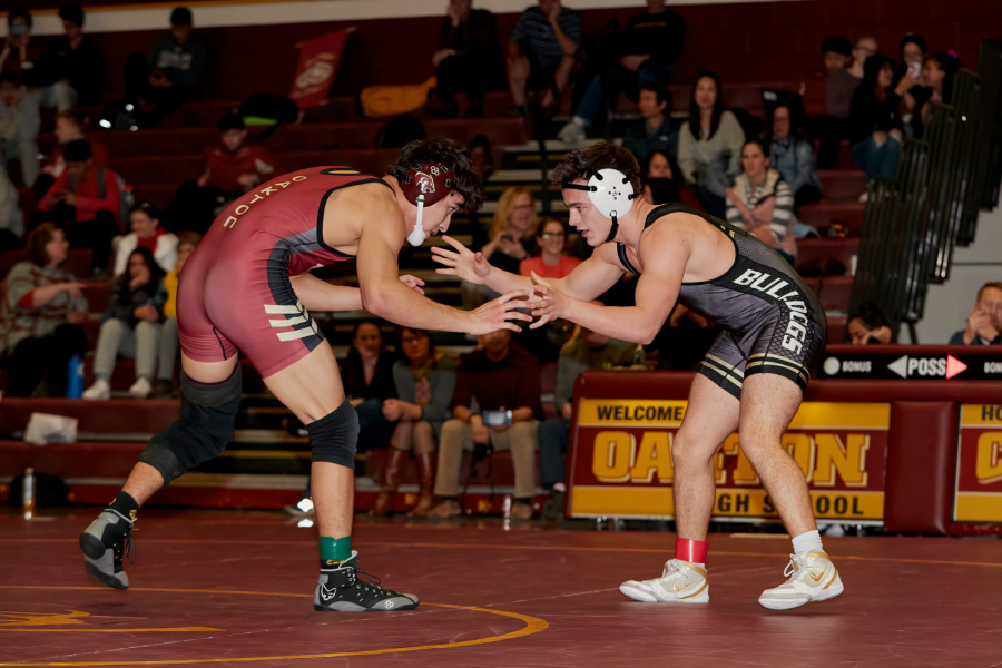 Moses competing at an Oakton Varsity Wrestling match.