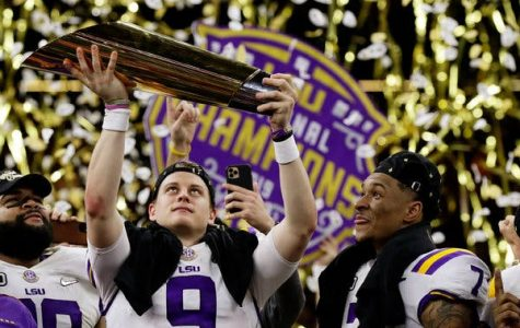 Joe Burrow holding the national championship trophy after beating Clemson 42-25.