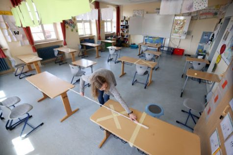 Schools in Germany setting up to return to school in the coming weeks, now with socially distanced tables among measures to prevent the spread of COVID.