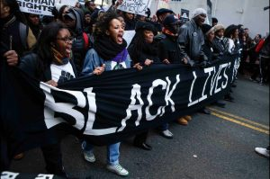 Protesters marched in outrage over the death of Tamir Rice, a 12 year old black boy, who was shot dead while playing with a toy gun. Photo Courtesy of CNN