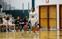 Reed brings the ball up the floor in a game against Centreville last year.